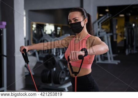 Sportswoman Wearing Medical Face Mask, Working Out At Gym During Pandemic