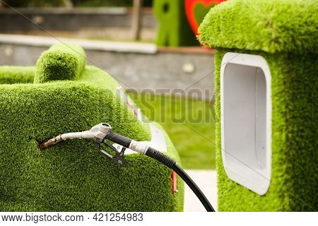 Green Grass Car And Gas Station. Environmental Protection, Maintaining Clean Air, Refueling Cars Wit