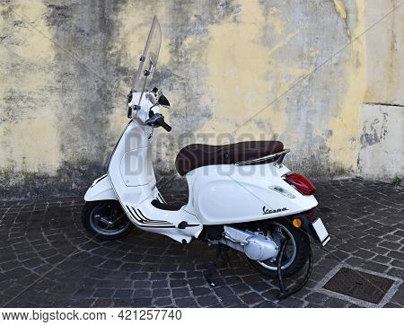 Lucca - Siena, Italy - August 6, 2020: Vintage Vespa Scooter Parked In The Street Of Lucca. Italy.
