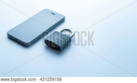 Business Security Protection. Modern Space Grey Mobile Phone With Padlock, Key On White Background.