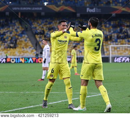 Kyiv, Ukraine - March 11, 2021: Ramiro Funes Mori And Raul Albiol Of Villarreal Celebrate After His