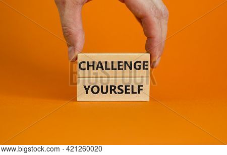 Challenge Yourself Symbol. Wooden Blocks With Words 'challenge Yourself'. Beautiful Orange Backgroun
