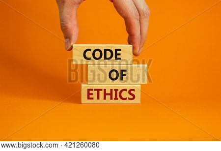 Code Of Ethics Symbol. Concept Words 'code Of Ethics' On Wooden Blocks On A Beautiful Orange Backgro