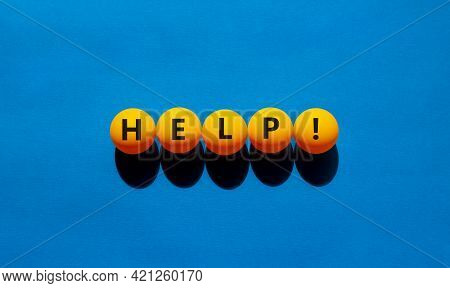 Support And Help Symbol. Orange Table Tennis Balls With The Words 'help'. Beautiful Blue Background,