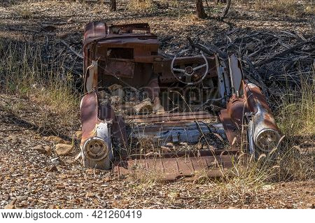 Rusted Out Dumped Wreck Of A Car Left To Rot In The Bush