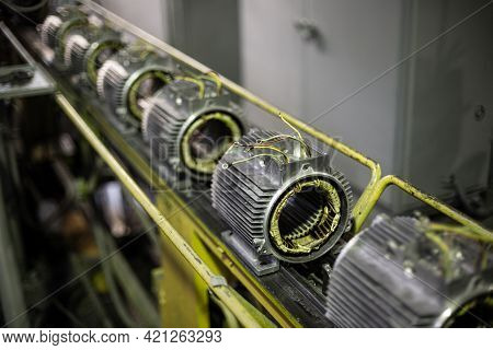 Stators Of Electric Motors On Assembly Line Of Semi-automated Manual Production. Equipment And Inter