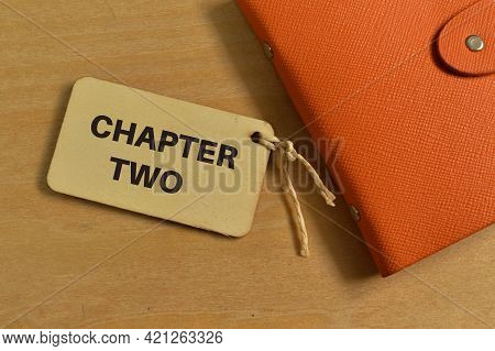 Top View Of Notebook And Label Tag Written With Chapter Two.