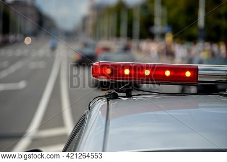 Minsk. Belarus - July 2016: Red Flashing Lights On The Police Car Against The Background Of A Road A