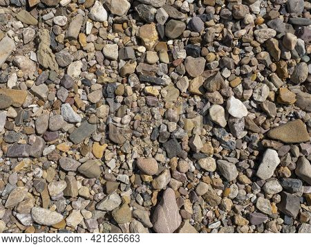 River Pebbles Close Up. Natural Pebble Beach. Background For Wallpaper, Texture.