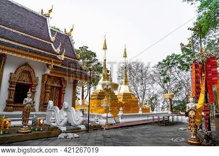 Wat Phra That Doi Tung, Famous Temple North Of Thailand. Thai Wording At Center-bottom Of Image That