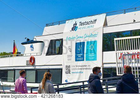 Heidelberg, Germany - April 2021: People Waiting At Corona Virus Test Station Called 'testschiff' On