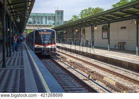 Vienna, Austria - April 28, 2018: The Metro Train Arrives At Schoenbrunn Station. Vienna Metro Green