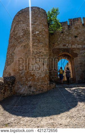 A Couple Going Up To The Castle Of The Town Of Chulilla And Its Famous Canyon In The Mountains Of Th