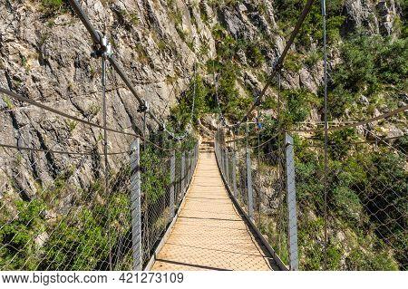 Suspension Bridges In The Loriguilla Reservoir. Ruta De Los Pantaneros In The Town Of Chulilla In Th