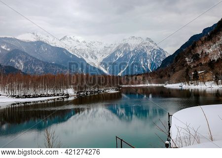 Landscape of snow mountain with rivers at the Kamikochi in Japan Alps Mountain. Winter season concept.