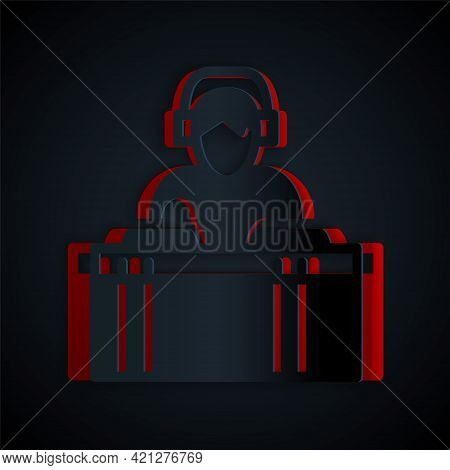 Paper Cut Dj Wearing Headphones In Front Of Record Decks Icon Isolated On Black Background. Dj Playi