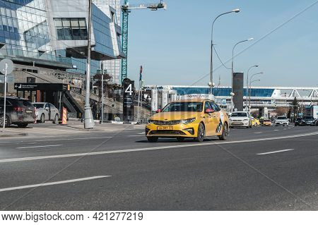 Yellow Yandex Taxi Car On The City Presnenskaya Street With Busy Traffic. Urban Scene With Taxi Cab