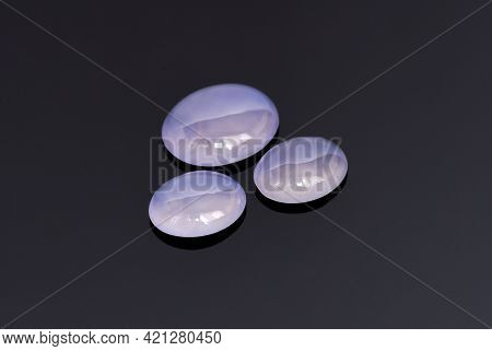 Natural Light Purple Chalcedony Oval Cabochon Trio Set. Glossy Polished Surface Of Semitrasparent Ge