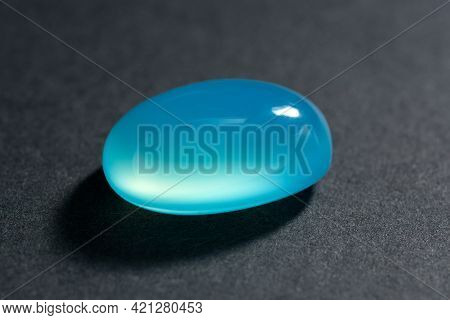 Natural Baby Blue Chalcedony Oval Cabochon Polished Gemstone. Heated, Color Enhanced, Increased Satu