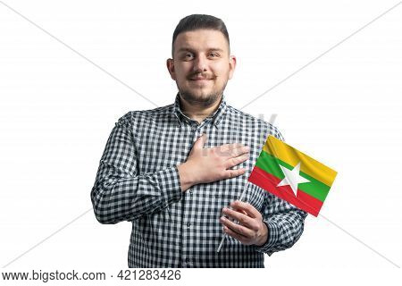 White Guy Holding A Flag Of Myanmar And Holds His Hand On His Heart Isolated On A White Background W