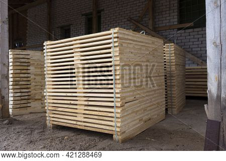 Detail Of Wooden Planks. Wooden Pallets. Wood. Lumber. A Stack Of New Wooden Planks In The Lumber In