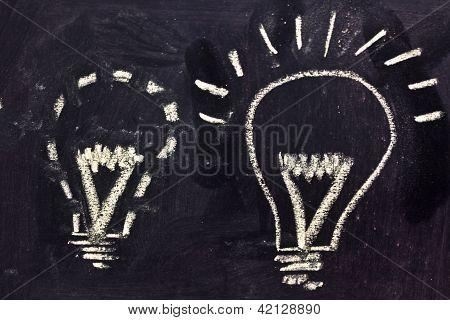 Building A Concept, Funny Lightbulb On Blackboard