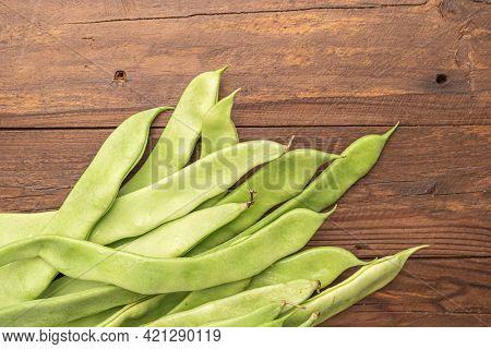 Raw Green Beans Closeup. Fresh Green Bean Also Known As French Beans, String Beans, Snap Bean, Snaps