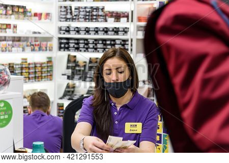 Russia, May 15, 2021: The Seller Serves Customers In The Store. Trade In Compliance With Sanitary St