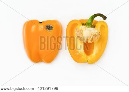 Moldy And Wrinkled Rotten Yellow Peppers Cut Into Two Halves. Concept Of Unhealthy, Decompose, Spoil