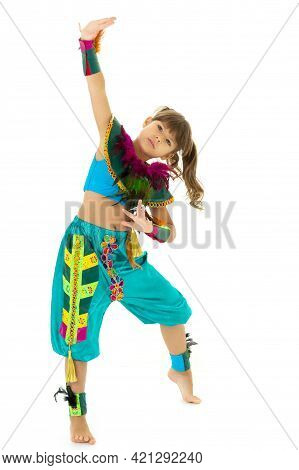 Lovely Girl Posing In Festive Costume. Cute Preteen Girl Dressed Traditional Colorful Dance Costume