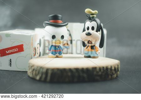 Samut Prakan, Thailand - May 22, 2021 : Cute Figurine Goofy And Scrooge Mcduck (mickey Mouse Family