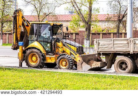 Samara, Russia - May 10, 2021: Tracror Loader On The Construction Of New Road. Industry Of Roadwork