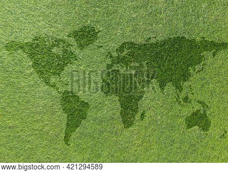 World Map On Green Grass Lawn Background For Global Eco-friendly Environment, Ecological And Environ