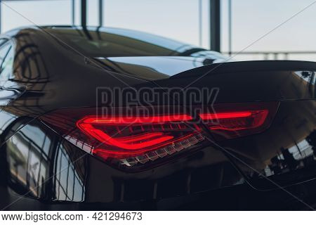Close-up Taillight Of A New Halogen Black Crossover Car. Exterior Of A Modern Car. Close Up Detail O