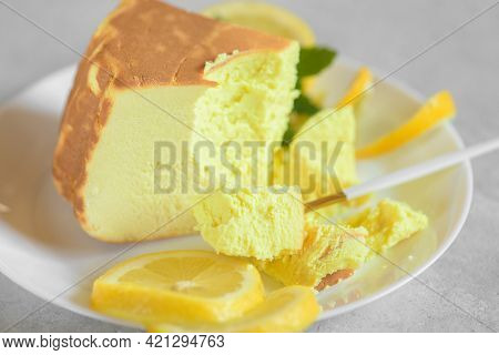 Delicious Lemon Cheesecake With Lemon On A Plate On A Grey Table, Zoom In. Italian Sweet Lemon Ricot