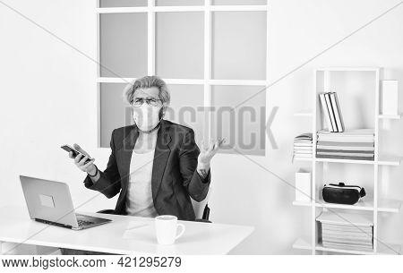 Man Freelancer Working Online. Guy Wear Mask While Surfing Internet. Limit Spread Disease. Remote Co