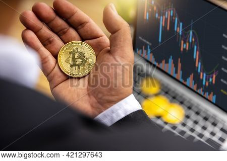 Close Up Bitcoin In Hand Of Businessman Trader Holding Cryptocurrency Profit And Income From Investi