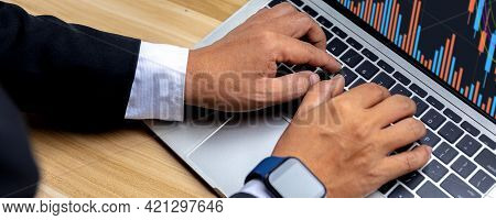 Close Up Hand Of Businessman Trader Trade Stock And Looking Financial Business Graph Data On Laptop