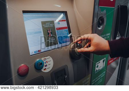 Brussels, Belgium - August 17, 2019: Man Buying A Ticket From A Machine At Metro Station In Brussels