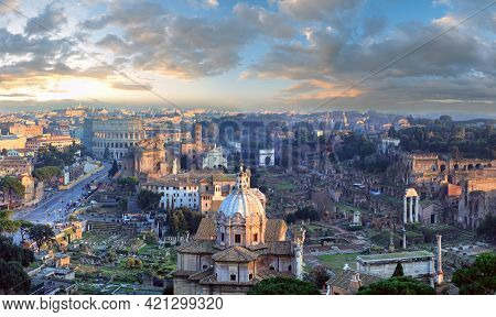 Ruins Of Roman Forum. Rome City Evening View From Ii Vittoriano Top. People Are Unrecognizable. Two