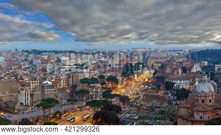 Ruins Of Roman Forum. Rome City Evening View From Ii Vittoriano Top, Italy. People Are Unrecognizabl
