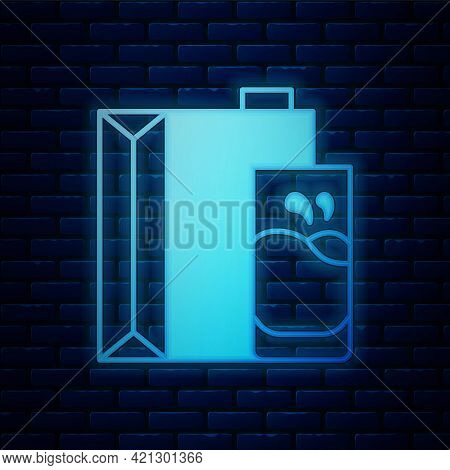 Glowing Neon Paper Package For Milk And Glass Icon Isolated On Brick Wall Background. Milk Packet Si