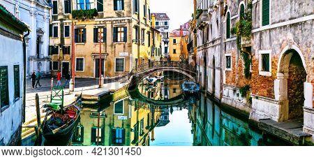 Romantic venetian canals with narrow streets.  Venice, Italy 02.11.2020