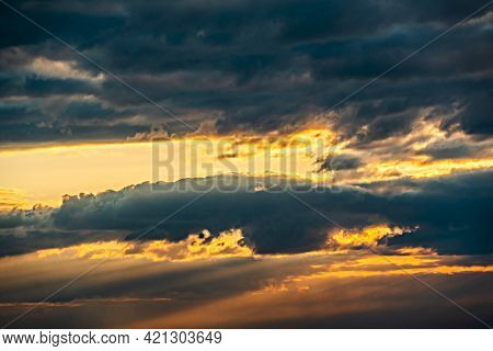 The Heavenly Light Of The Sun.dramatic Evening Sky With Clouds And Rays Of The Sun.sunlight At Eveni