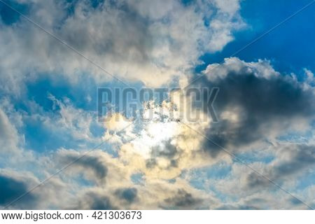 The Rays Of The Sun Break Through The Clouds.blue Sky With White Feather Clouds. Panoramic View Of T