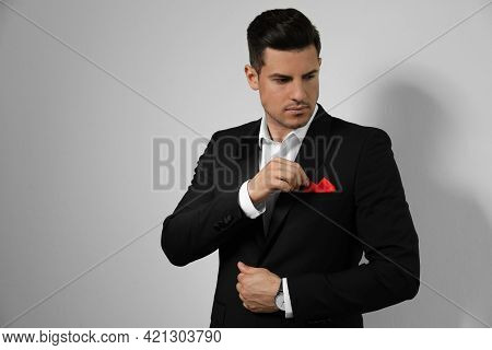 Man With Handkerchief In Breast Pocket Of His Suit On Light Background, Space For Text
