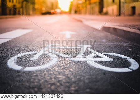 Separate Bicycle Lane For Riding Bicycles. A White Bicycle Symbol On The Road. Selective Focus