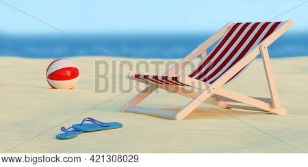 Deck Chair, Ball And Pair Of Flip Flops On The Beach With The Sea In The Background. Selective Focus