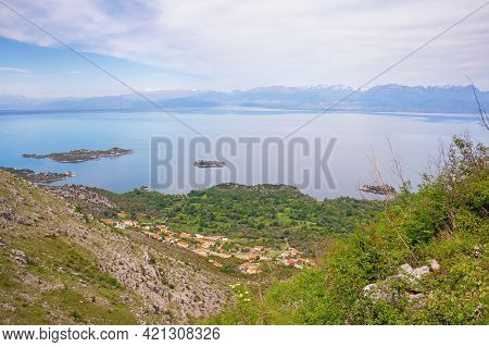 Beautiful View Of Coast Of Lake Skadar  With Small Islands On Spring Day. National Park Lake Skadar,