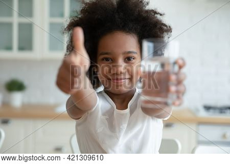 Portrait Of Happy African American Girl Child Recommend Clean Water